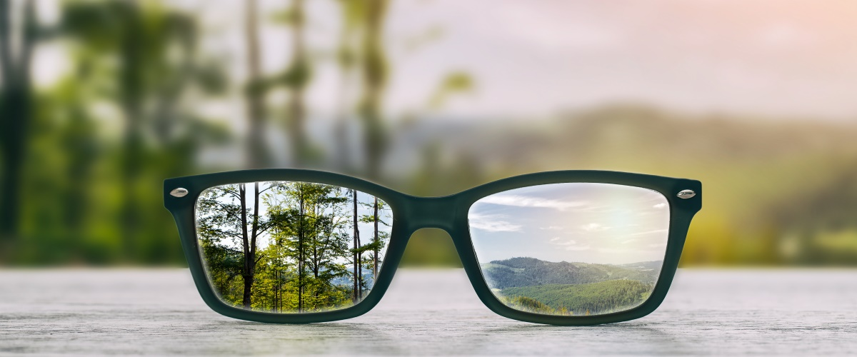 Glasses focusing on beautiful scenery