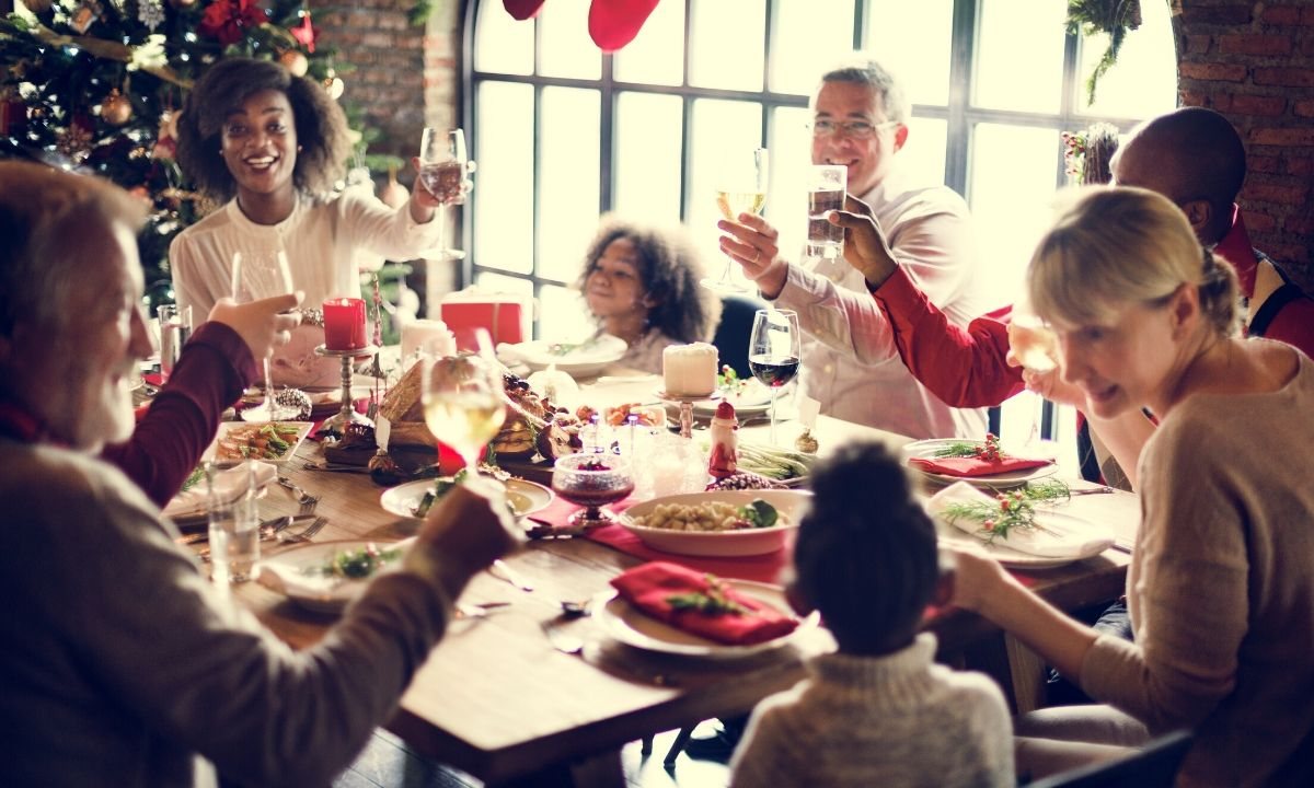 Family enjoying drama-free holidays at dinner table